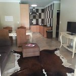 Entrance into unit. Fully equipped kitchen/living area/TV room