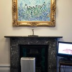 A beautiful period fireplace which has been improved by a Delonghi heater and a Ted masterpiece