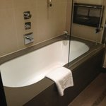 Lovely large bath, and television in our bathroom!