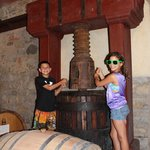 Kids with the old wine press