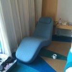 Lovely relaxer chair in bedroom.