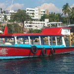Glass-bottom boat that takes visitors from Caleta to la Roqueta