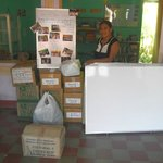 Vanesa, owner of the school, with school books and other supplies donated by Casa Nica School