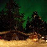 northern lights over reception at igloo village