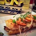 Sweet plantain topped with garlic shrimp, cheese and 3-alarm cajeta sauce