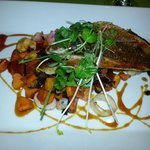 Ultra Fresh Red Snapper sauteed and placed over a melange of mussels, calamari, sweet potatoes