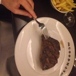 A perfect medium rare rib eye 300g with delicious truffle fries