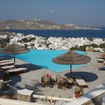 View of Vencia's pool, the town and the Bay of Mykonos