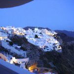 View of the cliffs of Santorini from our balcony at night....beautiful.