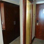 mirror and door leading to bathroom