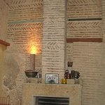 The fireplace at one end of the indoor section.