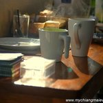 Steaming mugs of freshly brewed coffee in the morning sunshine