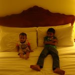 My kids relaxing in king size bed