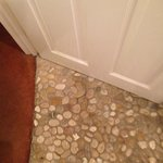 Pebbled shower room floor.