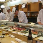 4 chefs serving 20