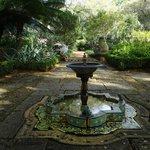 A fountain near the Mediterranean-style mansion