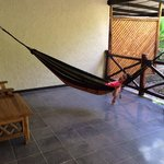 Large porch area with table, chairs and required hammock!