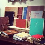 Handmade upcycled journals and sketchbooks made from recycled books and leather.