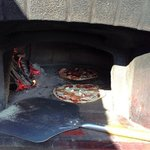 Enjoy Woodfired Pizzas take out or eat in