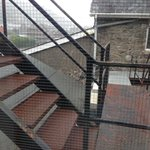 View of fire escape from bedroom window