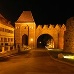 Hotel (night view) to the left of the photo just inside one of the city wall gates