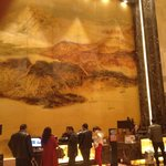 Patrons dwarfed by 3 Georges painting at reception