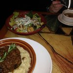 Slow cooked beef ribs over risotto, grilled seafood salad, and chicken soup.