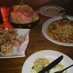 Red snapper sashimi, spicy tuna crispy rice sushi, papaya salad