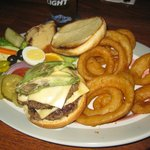 Beef Burger with onion rings and many other delicious additions
