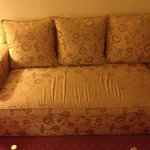 Worn out sofa in room