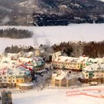 The village at Mont Tremblat with the lake behind it covered in snow