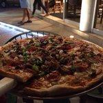 Mama's specialty pizza add Italian sausage