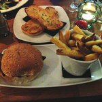 Chicken Burger, Chips and a side of Garlic Bread.