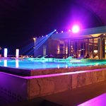 pool and restaurant by night