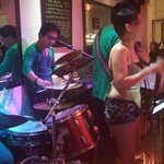 Filipino band on restaurant floor.