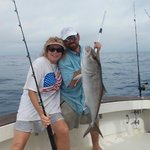 this little lady worked to bring this Amberjack in