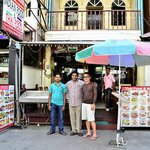 My friend with Mr Sunil and his staff in front of the shop