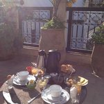 breakfast on the terrace in the morning sunshine