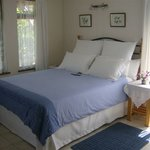 Extra-length queen-size bed in Bougainvillea suite