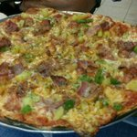 Four cheese pizza with bacon, green pepper and onion. Yummy
