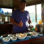 Captain John preparing sunset snack platters