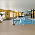 Indoor pool with slide and hot tub