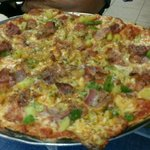 4 cheese pizza with bacon, green pepper and onion