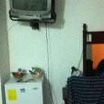 Wall mounted TV, mini fridge and desk