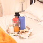 Breakfast in bed at Tumaini Cottage