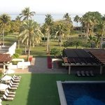 hotel garden, sipwimming pool and the beach
