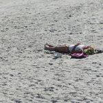 Beautiful People Tanning on the shore