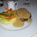Roast pork with sauce and veg