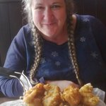 A happy smile and Fish N' Chips!