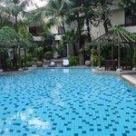 Quiet hidden away pool, garden rooms open out onto this area